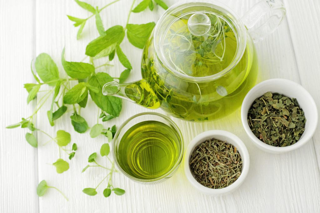 healthygreen tea cup with tea leaves