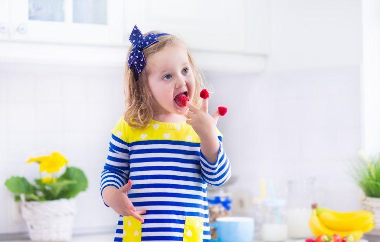 Little girl in white kitchen.