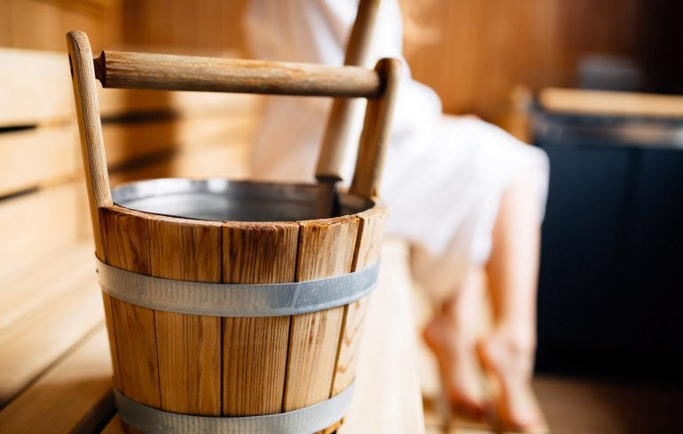 Wooden bucket in Finnish sauna.