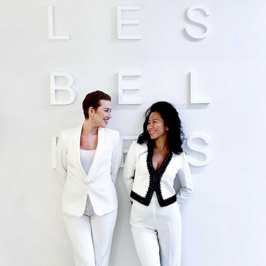 Dr Huang and Dr Bridget in front of Les Belles sign.