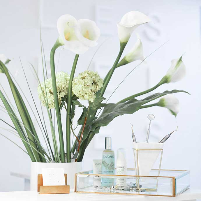 White flowers and cosmetic creams.